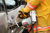 picture of spreader  - Firefighers popping the door with a hydraulic rescue spreader at a extrication drill in Roseburg Oregon - JPG