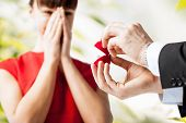 stock photo of excitement  - picture of couple with wedding ring and gift box - JPG