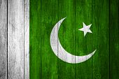 stock photo of pakistani flag  - flag of Pakistan or blue white and green Pakistani banner on wooden background - JPG