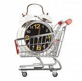 Shopping cart with alarm clock isolated white background