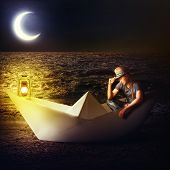 Man Traveler Sitting In Fantasy Paper Boat