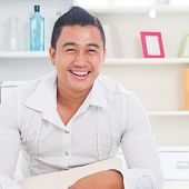 pic of southeast asian  - Good looking young Asian man smiling happy - JPG