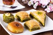 stock photo of baklava  - traditional turkish baklava and pastry and tea - JPG