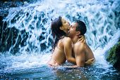 image of waterfalls  - Couple hugging and kissing under waterfall - JPG
