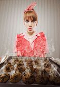 foto of stereotype  - A Retro young housewife burnt the cookies - JPG