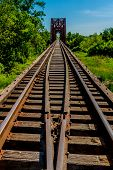 stock photo of trestle bridge  - Converging Line of Railroad Tracks  - JPG
