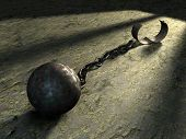 stock photo of ball chain  - Steel ball and chain in a prison cell - JPG