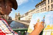 ST.PETERSBURG, RUSSIA - JUN 22: Unknown artist paints the Church of the Savior on Spilled Blood, Jun
