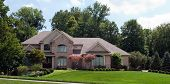 picture of manicured lawn  - Grand Suburban Brick Home - JPG
