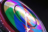 stock photo of funfair  - Multi Magic colored spinning wheel, image for wallpaper