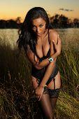 African-American woman wearing black lingerie