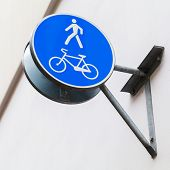 Blue Pedestrian Zone Road Sign On Building Wall