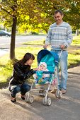 Happy Family Outdoor With Carriage