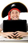 Young Man In Pirate Costume And Computer