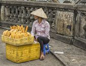 Young Woman Selling Fresh Baked Bread In The Street.