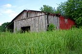 Barn in Grassy Field