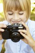 Young girl holding camera