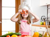 foto of chef knife  - Funny chef kid girl cooking at kitchen - JPG