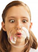A Girl Inflates Soap Bubble
