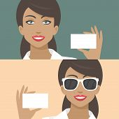 Woman smiling and holds business card