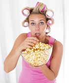 Woman With Curlers Eating Popcorn