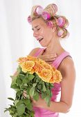 Woman With Curlers And A Bouquet Of Roses