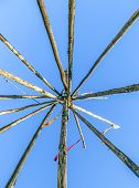 Tipee Stakes And Ribbons Shown Against A Blue Sky