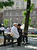 PENSIONER IN THE CENTER OF KIEV, KHRESCHATYK STREET - JUNE 2014.