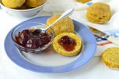 Pumpkin scone with strawberry jam