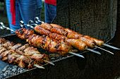 Grilled Sausages And Meat On Barbecue