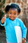 Cute African Girl With Notebook.