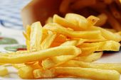 French Fries Scattered On Table