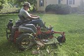 Landscaper on riding lawn mower