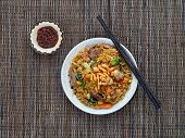 stock photo of nasi  - Traditional Indonesian dish made of fried rice with pork meat and vegetables  - JPG