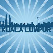 stock photo of kuala lumpur skyline  - Kuala Lumpur skyline reflected with blue sunburst illustration - JPG