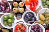 Colorful Assortment Of Cured Olives And Peppers