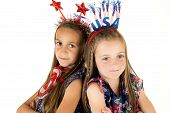 Cute Girls Wearing American Patriotic Headbands Back To Back Smiling