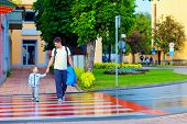 stock photo of zebra crossing  - father and son crossing the city street on crosswalk - JPG