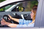 Young woman is driving car