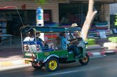 Bangkok, Thailand - May 23, 2014: Unidentified Driver And Tourists In Tuk-tuk Vehicle Along The Road