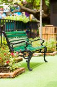 Antique Chair In A Green Garden