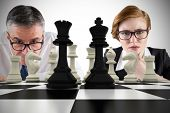 Composite image of business people and chessboard against white background with vignette