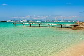 Formentera Tropical Mediterranean Sea Wooden Pier In Illetes Beach Balearic Islands