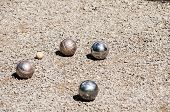 Petanque balls on gravel alley