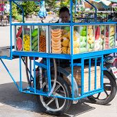 Kanchanaburi, Thailand - May 23, 2014: Fresh Fruits Vendor On Streets Of Kanchanaburi, Thailand