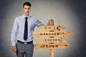 Success businessman with main postulates of successful business on wooden sign