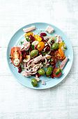 Tuna salad with cherry tomatoes, olives and beans