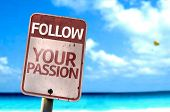Follow Your Passion sign with a beach on background