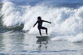 Athlete Surfing On Santa Cruz Beach In California