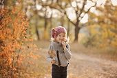 cute happy child girl on the walk in autumn forest